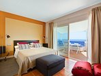 Main bedroom with queen size bed and private terrace. Equipped with fireplace and air conditioner.
