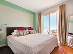 Top bedroom with queen size bed and private terrace. Equipped with air conditioner and Full HD TV