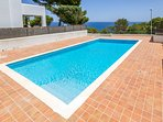 Large communal swimming pool with sea view