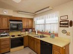 Save yourself some money by cooking in this fully equipped kitchen.