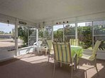 Enjoy bug free evenings in this screened in patio / Florida room.