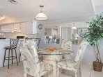Dining room with 4 top table and chairs and 3 barstools