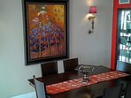 The elegant dining table, which seats 6 people with ease, there's room for another 4 guests