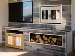 Built in wood burner and large tv.