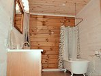 Recently renovated full bathroom featuring claw foot tub.