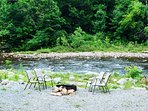 Fire ring with outdoor seating by river available.