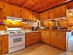 Cook up delicious home-cooked meals in the expansive, fully equipped kitchen.