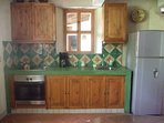Kitchen with refrigeraton and stove