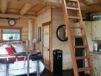 Water cooler, fridge and ladder to the loft.