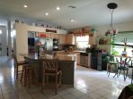 Huge open concept kitchen w/ 2 granite islands, coffee pot, silverware, blender, waffle maker & more