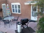 Outside is the patio where you can relax and grill.