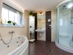 En-suite bathroom with Jacuzzi bath, Hydro-massage shower cabin and hammam