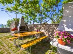 Large common barbeque & seating area with sea view