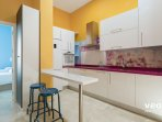 Modern kitchen with utensils for cooking and main appliances.