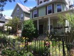 A 100 year old Victorian 3-family house with a beautiful garden in the front