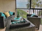 Enjoy the stylish and screened in Gulf front balcony at Arie Dam 102 in Madeira Beach, FL