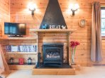 Solid cast iron gas log effect feature fire. A selection of DVD's to choose from.