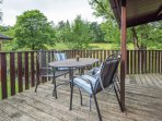 Relax on your decking listening to the soothing sound of the river.