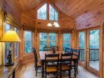 Dining area with lots of windows overlooking the mountains