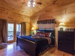Master bedroom upstairs with a private deck overlooking the mountain tops