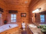 Master bathroom upstairs with a jacuzzi tub