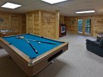 Terrace level game room with a pool table and foosball table