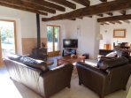 The lounge with sumptuous leather sofa and wide screen TV