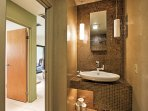 Freshen up in this clean, tastefully decorated bathroom.