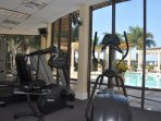 Gym with view of pool area