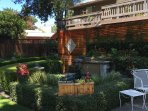 Fish pond in backyard and access to Perfect Balance Day Spas' The Hideaway.
