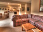 Living Room - The large sectional sofa pulls out to a queen size bed to sleep 2 additional people.