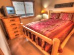 Master Bedroom - The master bedroom features a queen size bed on a custom hand made log bed.