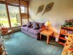 Living Room - Plenty of sun from the floor to ceiling windows.