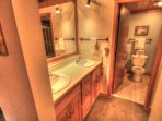 Master Bathroom - The master bathroom features double sinks, a shower/tub combination, and a large walk in closet.