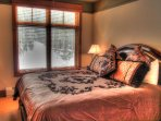 Master Bedroom - Master bedroom features a new king size bed with luxurious bedding on leather inlaid furniture.
