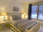 Master Bedroom - Master bedroom features a queen size bed on a custom handmade log bed.