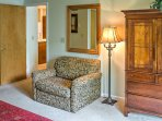 Large armchair in master bedroom is a twin sleeper, armoire contains flat screen TV with HD cable.