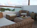 Rooftop terrace with wetbar, lounging chairs, tables, and jacuzzi tub
