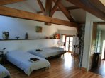 Loft with three single beds, a sofa-bed and an en-suite bathroom