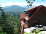 Gorgeous upscale log home overlooking layers of the Smoky Mountains. Smoky Mountain Heaven!