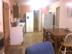 Kitchen w/fridge, stove, microwave & coffee maker.  Basic pots/pans & dinnerware.