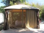 Stay in a lovely fully carpeted canopy tent with access to the amenities of wonderful home.
