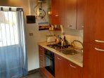 Well equipped kitchen with gas hob and electric oven