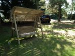 Relax on the wooden garden swing.