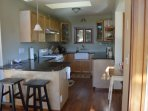Fully appointed kitchen with breakfast bar, dining nook on the right