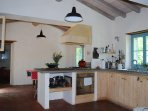 Open plan kitchen/dining room. Equipped for serious cooks with top cookware & inspiring recipe books