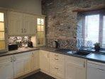 Kitchen with dishwasher and Nespresso machine