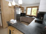 Well stocked separate kitchen with breakfast bar