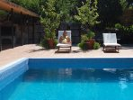 Poolside, surrounded by authentic ancient Greek walling