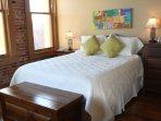 Master bedroom with original red brick walls.